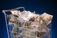 Shopping Cart filled with United States Currency